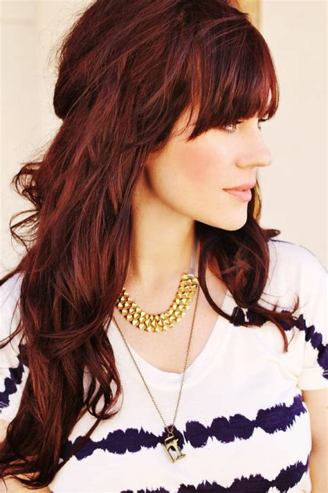 what are the bangs that have a deep part and go across youur forhead stylenoted great cut color combinations deepest