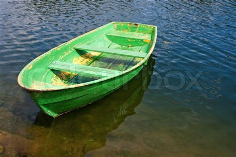 old green rowing boat on a lake stock photo colourbox - Green Boat Pictures