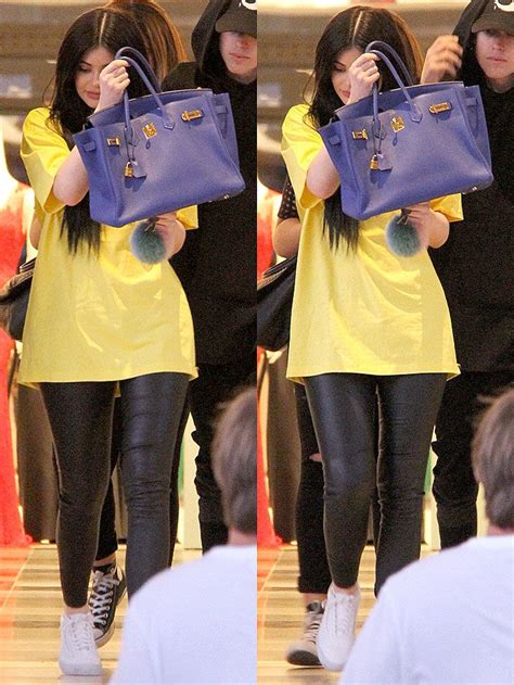 Shields Hermes Birkin by Jenner Holding Up Blue Hermes Birkin Bag To