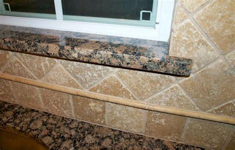 granite window sill with travertine tile backsplash house yard pinterest brown granite