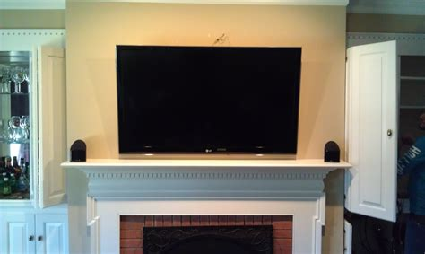 Concealed Tv Fireplace by Surround Sound Home Theater Installation