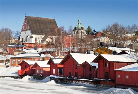 Red wooden houses on the river coast in Porvoo town