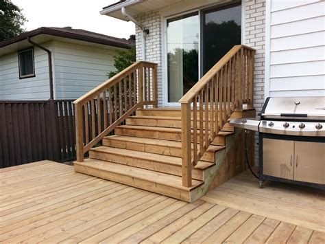 Stairs From House To Patio by A Top Notch Construction And Renovations