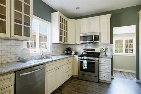 Kitchen With Off White Shaker Style Cabinets White Subway