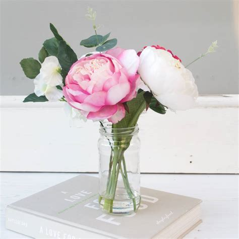 white and pink peony bouquet in vase by abigail bryans