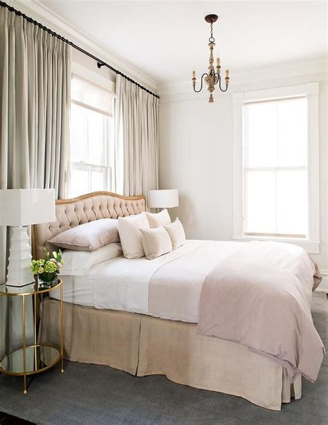 sophisticated pink bedroom sophisticated bedroom features a a dusty pink tufted headboard with wood frame on bed