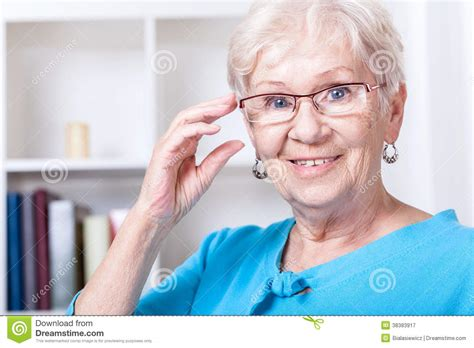 grandmother wearing reading glasses royalty free stock
