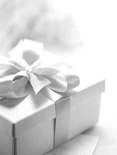 white gift wrap white gift wrapping pretty presentations