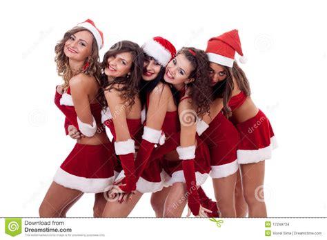 imagenes santa claus mujeres abrazo grande de la navidad del grupo imagenes de archivo
