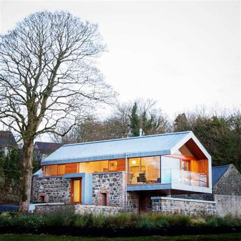 Stone and Glass Barn: Contemporary Style for a Traditional