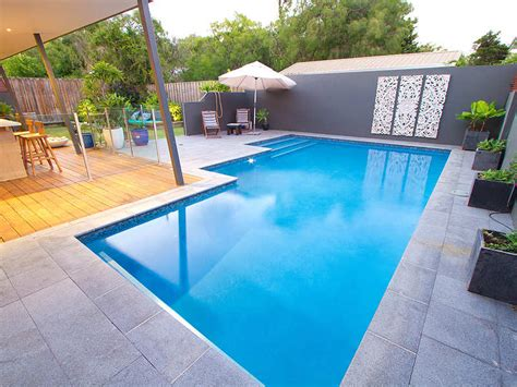 geometric pool designs geometric pool design using grass with retaining wall