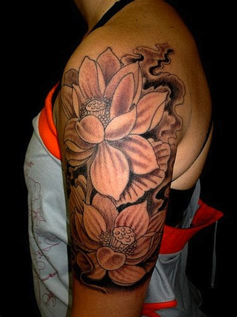 lotus tattoo in arm 155 lotus flower tattoo designs