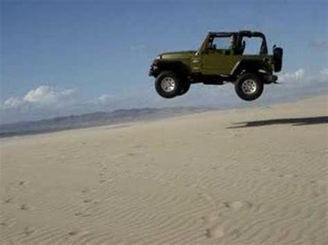 sand dune jeep jeep jump at pismo sand dunes