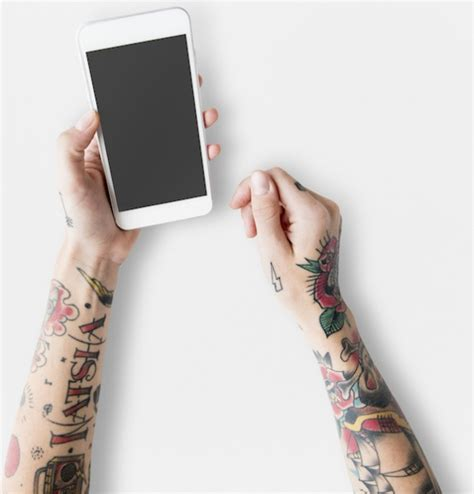 mockup for tattoo free hand with tattoos using mobile phone mockup free psd