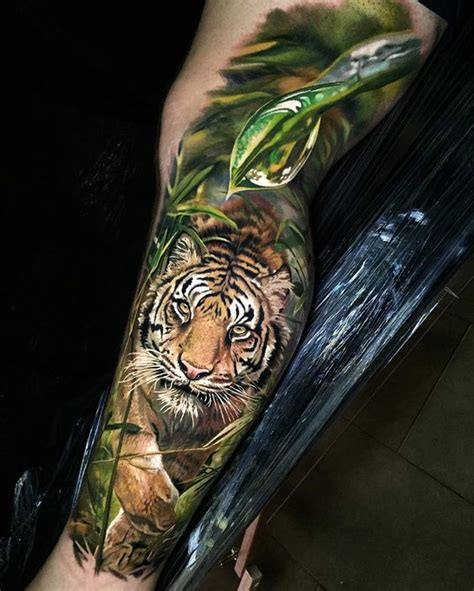 new school jungle tattoo realistic tiger in the jungle best tattoo ideas