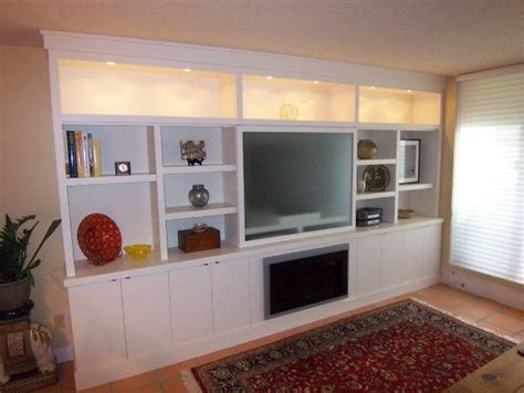 room wall storage wall cabinets living room display cabinets with puck lights and lower storage with