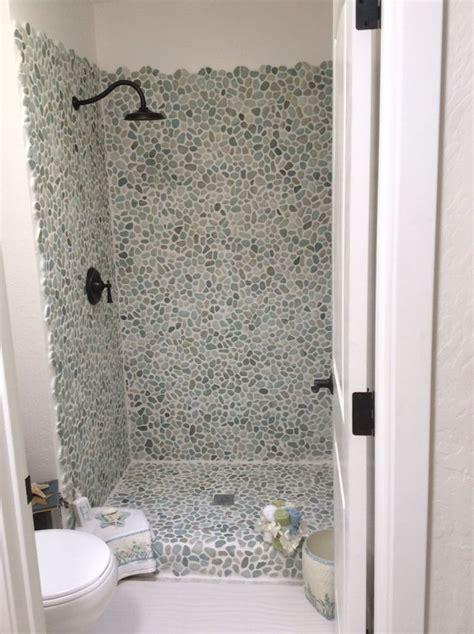 white pebble tiles bathroom 25 best pebble tile shower ideas on pinterest