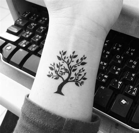 small tree tattoo 101 small tree designs that re equally meaningful