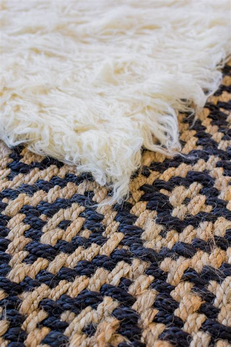 layered rug how to layer rugs like a pro the fox she
