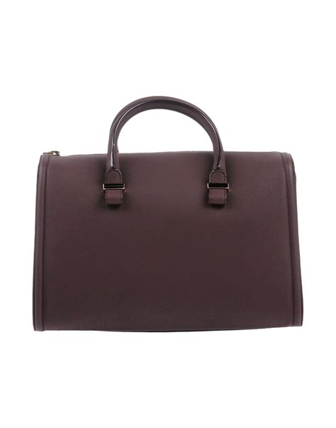 Beckham With Marc Handbag by Lyst Beckham Handbag In Brown