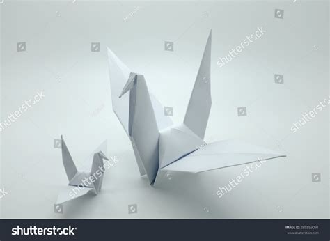 Origami Paper White - white origami crane bird paper stock photo 285559091
