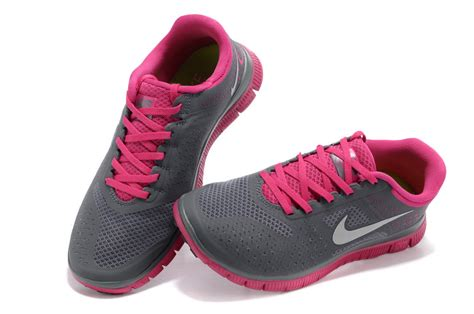 gray and pink nike running shoes lib value