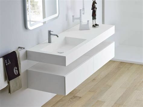 Unico Countertops by Unico Washbasin With Integrated Countertop By Rexa Design