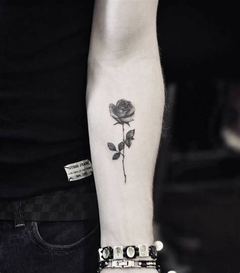 fine line tattoo artists line on the left inner forearm