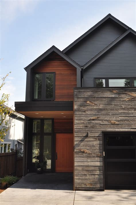 modern exteriors rustic wood siding exterior contemporary with black garage