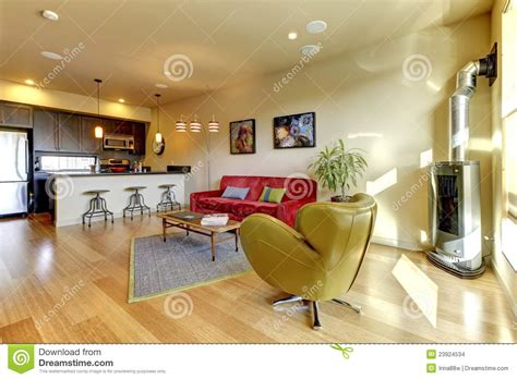 couch in the kitchen yellow living room ith red sofa and kitchen stock photo