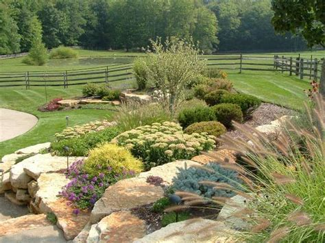 close up view of hardscape planters incorporated into the design of this landscaped hillside
