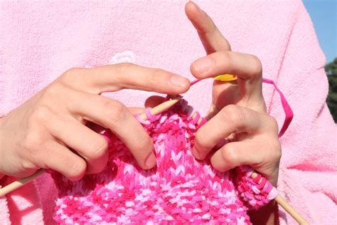 meaning of knits file pink knitting in front of pink sweatshirt jpg