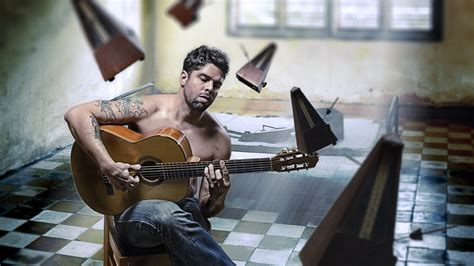 who is the guy that plays guitar and sings on the new direct tv commercials man playing guitar wallpapers and images wallpapers