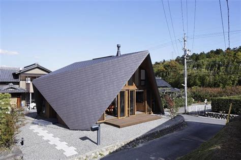 Origami Roof - home surrounded by rock wall and protected by folded roof