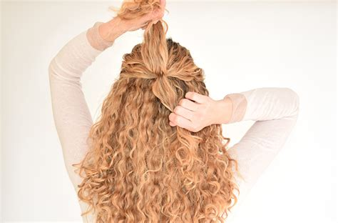 curly hairstyles pulled up how to create a pull through braid in naturally curly hair
