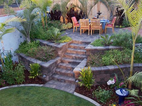 how to fix a sloped backyard retaining wall ideas palm trees grow easily in out sunny
