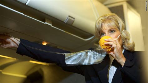 Flight Attendant In Ct by Flight Attendant Demonstrates Safety Procedures Before Takeoff The Pictures