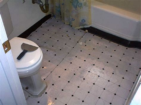 linoleum flooring bathroom good lord what the hell is this under the linoleum we