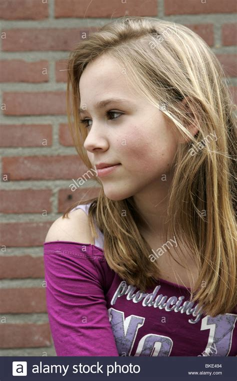 pre teenagers models pretty daydreaming preteen girl outside looking aside