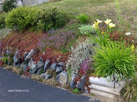 garden rock walls retaining walls turn a retaining wall into a rock garden