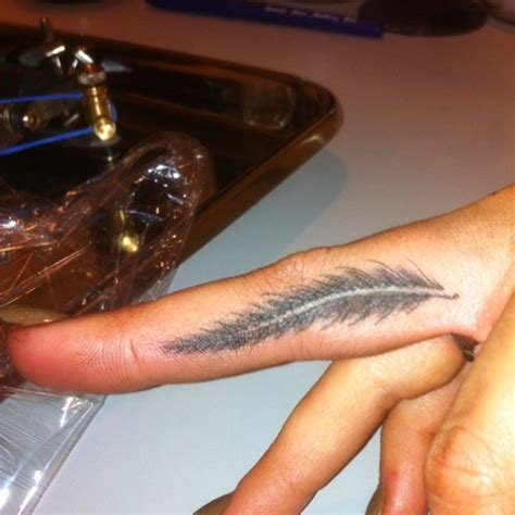 feather tattoo on hand feather on finger the rebel inside