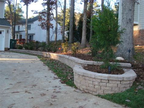 driveway design on hill retaining wall planter along driveway