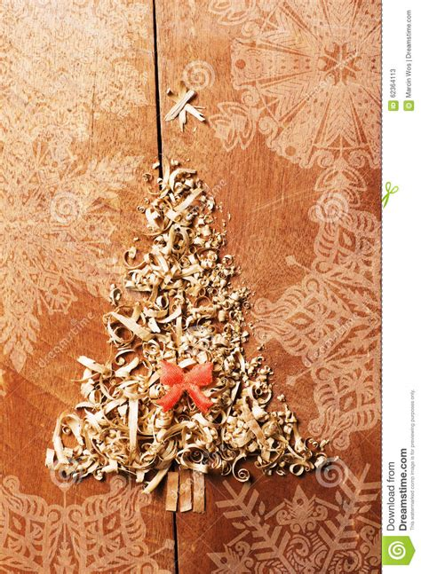 simple xmas wood simple tree arranged from sawdust wood chips on wooden background orange ribbon