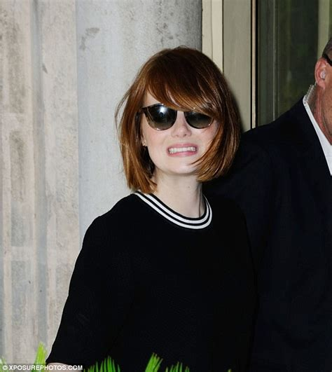 emma stone cuts flawless figure at venice film festival in