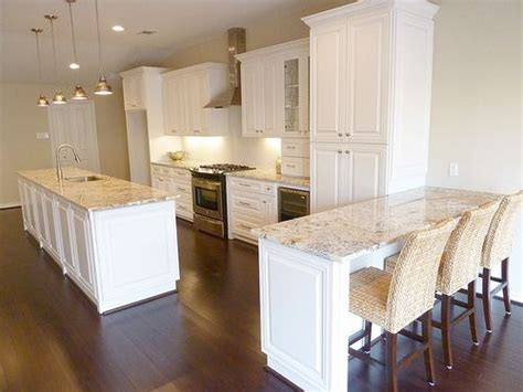white kitchen island with granite countertop and prep sink honed snow white granite google search sweetwater