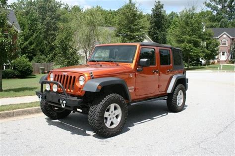orange jeep lifted orange jeep wrangler lifted nitto thread lifted 4 doors