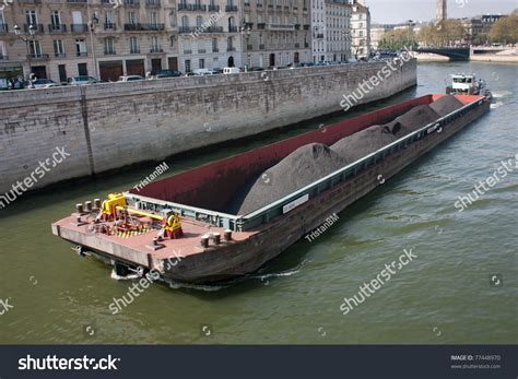 boat shipping stocks canal boat shipping merchandise on river stock photo