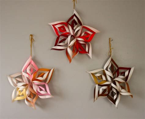 recycle paper by making easy snow flakes for christmas
