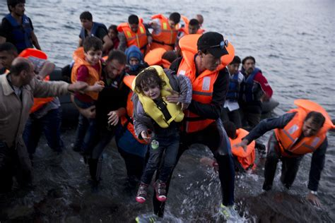 syrian refugee crisis boat human towers in spain endurance motorcycle race migrant