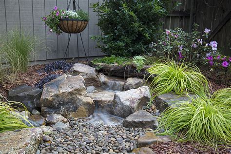 aquascape inc aquascape inc introduces innovative backyard waterfall landscape fountain kit pond